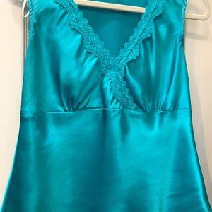 Turquoise sleeveless blouse